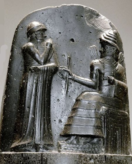 Hammurabi (standing), receiving his royal insignia from the god Shamash (relief on the upper portion of the stele of Hammurabi's Code, the Louvre Museum, Paris).